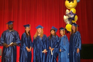 RCC-Grads-against-Red-Curtain-with-Diplomas-2007